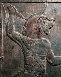 Our version of the elusive Assyrian king, Ashur-nadin-apli. Detail of relief depicting figure of guardian lion, from ancient Nineveh, Iraq / De Agostini Picture Library