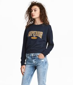 Dark blue. Lightweight sweatshirt with a printed design. Dropped shoulders, long sleeves, and ribbing at neckline, cuffs, and hem.