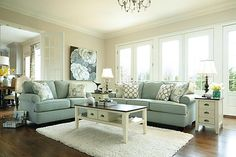 """The Daystar - Seafoam Sofa from Ashley Furniture HomeStore (AFHS.com). The """"Daystar-Seafoam"""" upholstery collection features stylishly shaped set-back arms along with the supportive seat and back cushion beautifully adorned with welt detailing to create an inviting contemporary styled collection that offers a refreshing look and the comfort perfect to enhance any living area."""