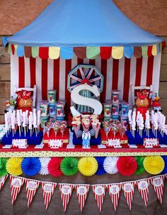 Circus Party or Carnival Party Theme Ideas - Table Decorations. IKEA HACK - the blue Big Top Tent backdrop is an inexpensive Bed Canopy from Ikea! via SIMONEmadeit.com
