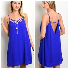 New! IRIS Royal blue mini dress IRIS Royal blue mini dress. This cute spaghetti strap woven dress features a cutout yoke with gold hardware and has a comfy flowy fit. Straps are adjustable. Material: 53% rayon, 47% polyester. Available in sizes S, M & L. Measurements available upon request. Price firm unless bundled. New with tags! Thank you for visiting my closet! Boutique Dresses Mini