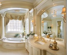 Large deep circular tub, huge mirror, curved vanity with plenty of counter space. Mmhmm! I'd ditch the windows, get rid of the pillars (they are pretty but just make it feel too fancy,) and change the color palette to something darker.