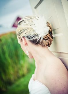 A different way to wear a birdcage veil: decoration at back of hair, with a floral or feather hair clip / comb. Love it!