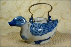This Chinese porcelain teapot with hand painted blue design detailing is simply adorable! Measuring 6 tall (including handle) and 8 long this