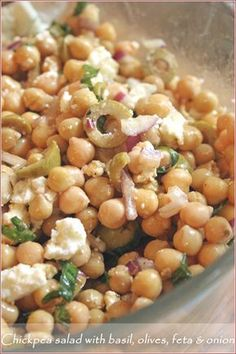 Chickpea Salad: 1 400g can Chickpeas, drained, 1/2 a sweet red onion, 100g feta cheese, fresh basil leaves, 12-15 pitted olives sliced, 3-4 T mild olive oil, lemon juice, salt and pepper to taste.