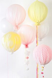 Tulle, lace, tissue paper, etc. could make colored balloons more pastel. I love the pastel colours for a baby shower.