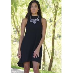 """Abby Dress Style yourself chic with your soon to be Abby dress! This light weight dress will having you looking best dressed at any party, wedding, or event. It features a hi-low cut and a key hole back that's secured with a button on top. Dress it up with strappy heels and a statement necklace, or dress it down with some knee high boots and a maxi cardigan.  - 100% Rayon  Micaela is wearing a size small Model's Profile:  Height 5'2"""" Bust 31.5"""" Waist 25"""" Hips 32"""" Dresses"""