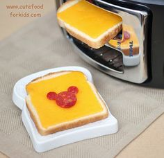 Turn Toaster Sideways to Make Grilled Cheese ... ps. the Mickey Mouse was cut from two slice of salami. One slice for the face; used straw to cut 2 little circles from the other slice.  It was placed on the grilled cheese after!