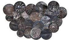 Coins from Bohemia, Germany, Denmark and England discovered during an archaeological dig last year, some of 365 items from the Viking era. Danish National Museum spokesman Jens Christian Moesgaard says the coins have a distinctive cross motif attributed to Norse King Harald Bluetooth, who is believed to have brought Christianity to Norway and Denmark. (AP PHOTO/POLFOTO/STOKKE BROTHERS)