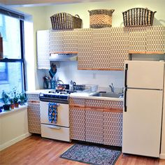 See this simple trick to add cool prints and patterns to your kitchen cabinets if you're a renter!