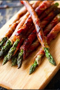 These are absolutely delicious and can be made in an electric fry pan. BACON WRAPPED ASPARAGUS: 10 fresh asparagus spears, trimmed; 5 pepper bacon strips, halved lengthwise. Place asparagus on a sheet of waxed paper; cot with cooking spray. Wrap a bacon piece around each spear; secure ends with toothpicks. Grill, uncovered over medium heat for 4-6 minutes on each side or until bacon is crisp. Discard toothpicks. Can bake in oven or cook in skillet until bacon is browned.
