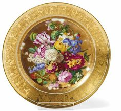 "Dish with floral still life  Brussels, Fréderic-Théodor Faber - around 1830  in the mirror colored painted floral bouquet, flag gilded with radiertem frieze of  winged lions. Porcelain. Sign at the bottom in gold. ""F. Faber M (ait) re R (oya) à le  Bruxelles"". Ø 23 cm."