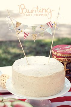 The cake bunting is really easy and adds a nice touch to your cake.  Supplies:  Xacto knife Ruler Wooden skewers String Double stick tape Bunting design