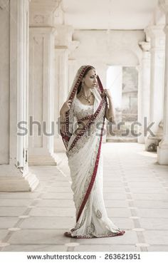 http://www.shutterstock.com/pic-263621951/stock-photo-beautiful-young-indian-woman-in-traditional-clothing-with-incense-bridal-makeup-and-oriental.html?src=O38RvhC9070csfUTJiSrkA-29-63