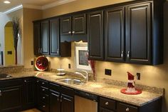 I am thinking of going with Black cabinets in my kitchen. We get A LOT of sunlight and the white cabinets only add to the brightness!