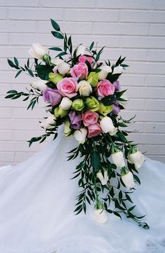 Bridal bouquet of pink rosews, lavender roses, white roses with italian ruscus in a crescent cascade. Wedding Bouquets, Wedding Flowers, Wedding Greenery, Sister Wedding, Wedding Stuff, Wedding Ideas, Flower Decorations, Wedding Decorations, Italian Ruscus