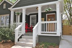 painted foundation | railing on porch and stairs | tiled porch | crown molding on porch ceiling and edge | trim detail on columns