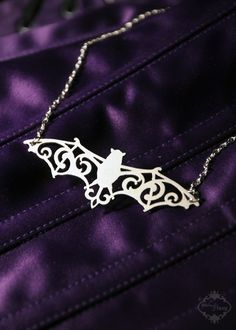 Filigree Victorian Bat necklace in silver stainless steel - vampire bat wings silhouette jewelry. $26.00, via Etsy.