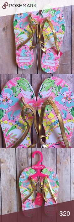 """Lily Pulitzer for Target """"Nosey Posey"""" Flip Flops Lily Pulitzer for Target """"Nosey Posey"""" Flip Flops. NWT, Sz 7, true to size. Signature pink floral print with gold upper straps. 9.75"""" length of sole. Materials: All Man Made Materials.   ⭐️ Bundle & Saved, No Trades ⭐️ Posh Compliant, Posh Rules Only ⭐️ All Offers Accepted or Countered ⭐️ Smoke & Pet Free Environment Lilly Pulitzer for Target Shoes Slippers"""