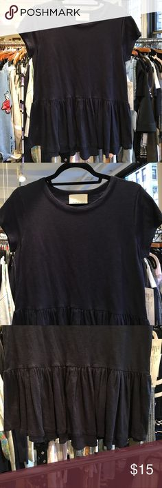 Short sleeve tee with peplum detailing Short sleeve tee with peplum detailing and crew neck line. Garment is 100% cotton Tops Tees - Short Sleeve