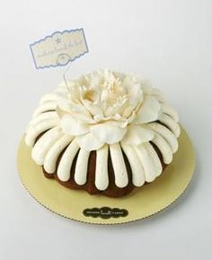 An elegant cake for any occasion, whether it's a ladies luncheon or a corporate event. The cream-colored silk flower matches our yummy signature frosting. Nothing Bundt Cakes, Sport Cakes, Ladies Luncheon, Torte Cake, Mothers Day Brunch, Elegant Cakes, Simple Gifts, Cupcake Cakes, Cupcakes