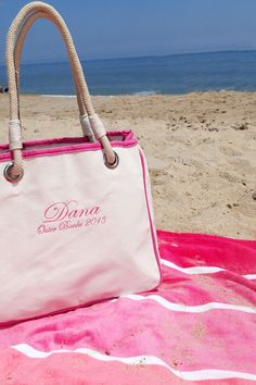 Perfect for running errands, heading to the beach, or an impromptu gift bag, the Rope Tote is a beautifully constructed natural canvas tote bag with contrasting hot pink trim. Featuring classic construction and timeless rope handles, this nautical inspired bag is one of our most popular giveaways among bridesmaids, teachers, moms and more! Consider personalizing it with a monogram for an even more thoughtful gift.