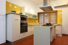 European-style kitchen with backsplash in yellow glass - we can provide ANY color to match your decor. classglassusa.com