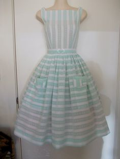 1950s style full skirted Audrey dress in genuine 50s mint green & white stripe Swiss cotton voile with patch pockets. Belt with 50s buckle.