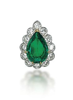 AN EMERALD AND DIAMOND RING, BY VAN CLEEF & ARPELS  Set with a pear-shaped emerald in a brilliant-cut diamond surround, ring size 4, with French assay marks for platinum and gold