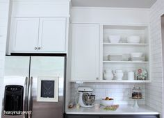 kitchen cabinet makeover - maybe we will keep the soffits... just have to rework the ones above the fridge and stove....