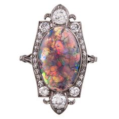 Art Deco Opal & Diamond Ring, circa 1925 Once-in-a-Lifetime Art Deco Opal and Diamond Plaque Ring. Outstanding art deco plaque ring, with an approximately 4 carat black opal, enhanced by a stylized frame of 1 carat of diamonds, set in platinum.