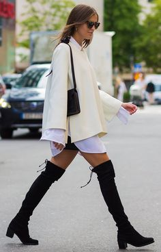 Over-the-knee boots with a white and ivory outfit. See more street style from Stockholm Fashion Week. Photographed by Photographed by Acielle / Style du Monde.