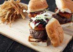 Beef slider with fried goat cheese smashed raspberries and balsamic