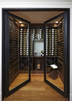 The double glass doors on this wine cellar add a sort of elegance to the libations. Cave A Vin Design, New York Penthouse, Wine Cellar Design, Wine Cellar Modern, Glass Wine Cellar, Home Wine Cellars, Home Wine Bar, Home Bar Designs, Wine Wall