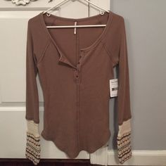 NWT Free People top brown long sleeve free people shirt! this shirt is brand new never has been worn it has tags! about three quarters down the sleeve the material becomes type of crochet. is very warm and comfortable Free People Tops Tees - Long Sleeve