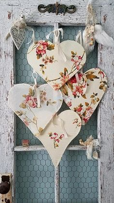 Vintage Flowery Hearts This beautiful set of flowery hearts are made from vintage fabrics in four pretty flowery patterns that will bring the flower garden inside and romance to any room it adorns! Abandoned wire hangers were hand tugged and pulled into four different shaped