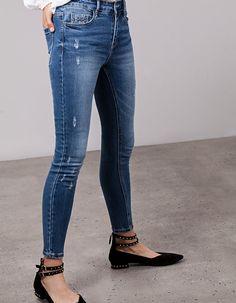 Calças high waist tachas