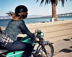 Girl on a green cafe racer
