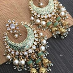 Cost is 2700 rupees including shipping within India. Colors available . Indian Jewelry Earrings, Indian Jewelry Sets, Gold Bridal Earrings, Jewelry Design Earrings, Silver Jewellery Indian, Gold Earrings Designs, Indian Wedding Jewelry, Ear Jewelry, Jhumka Designs