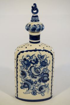 """Russian ceramic decanter with stopper in the Gzhel style. Beautiful hand painted blue and white folk-art design. Details: - Measures about 10"""" tall (to the top of the finial). Condition: - Part of our"""