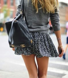 Short flowy leopard print miniskirt, grey sweater, thin bracelets & chanel backpack / bag