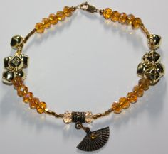 I really like this ... it's so, ME ... lol  [Ochun Oshun  inspired Ankle bracelet by ModernOrisha on Etsy, $15.00]