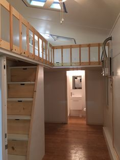 tiny house on wheels with loft railing, storage compartments in stairs built by Tiny Idahomes