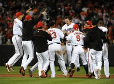 Orioles players congratulate third baseman Kelly Johnson, center, after his walk-off RBI double in the bottom of the ninth inning against the New York Yankees at Camden Yards.