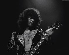Who else can rock the chest hair/pendant look with such aplomb? | 29 Reasons Jimmy Page Is The Most Badass Person Alive