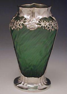 ManufacturerA J Orivit of Cologne  DesignerFreidrich Adler  DescriptionLoetz glass vase with polished pewter mount  Country of ManufactureGermany  Datec.1905