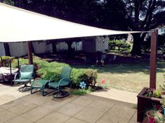 Need a budget-friendly solution for a sunny yard? Install a sun shade sail with this easy tutorial. From installing the posts to attaching the sail, you can easily enjoy more shade this summer with this simple tutorial. #diy #easy