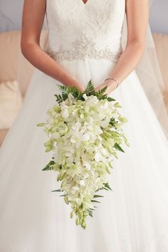 Cascading bouquet of orchids | Photography: Duüet Photography - duuet.com.au  Read More: http://www.stylemepretty.com/australia-weddings/2014/04/23/classically-romantic-overnewton-castle-wedding/