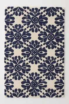 I also like the brown and red version of this rug, but I like the blue the most.