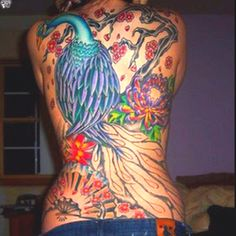 Another amazing Asian-styled peacock full-back tattoo.